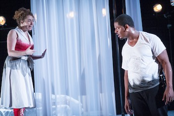 Emilia, portrayed by Melissa Carter, left, pleads with Othello, played by Kenn Hopkins Jr, right, during one of the later scenes in the play.