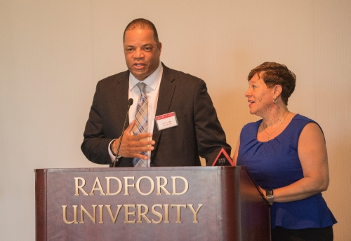 2017 Outstanding Service Award Winners David and Pebbles Smith, '85 give their acceptance remarks after receiving their award at Friday's Alumni Volunteer Leadership Business Lunch and Awards Ceremony in Kyle Hall.