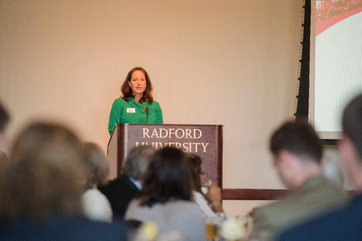 Guest Speaker Lisa Ghiodatti addresses the audience during her remarks to the Alumni Volunteer Leadership Business Lunch and Awards luncheon.