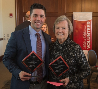 2017 Young Alumnus Merit Award winner Sean K. Gallahan '08 with 2017 Outstanding Alumni Philanthropist Award winner Jeannie M. Allman '67 after Friday's Alumni Volunteer Leadership Business Lunch and Awards Ceremony in Kyle Hall.