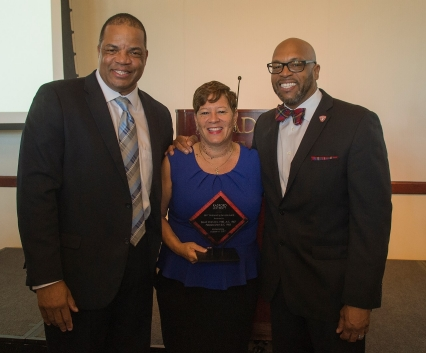 2017 Outstanding Service Award Winners David '85, M.S. '87 and Pebbles '85 Smith with Radford University President Brian O. Hemphill after Friday's Alumni Volunteer Leadership Business Lunch and Awards luncheon in Kyle Hall.