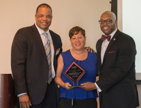 2017 Outstanding Service Award Winners David '85, M.S. '87 and Pebbles '85 Smith with Radford University President Brian O. Hemphill during Friday's Alumni Volunteer Leadership Business Lunch and Awards Ceremony in Kyle Hall.