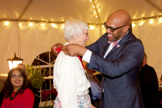 President Brian O. Hemphill, Ph.D., inducts a member of the Class of 1967 with a medal in honor of her alma mater.