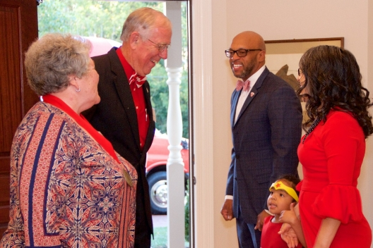 President Brian O. Hemphill, Ph.D., Radford University First Lady Dr. Marisela Rosas Hemphill and their daughter, Catalina, welcome alumnae from the Class of 1967 to the Governor Tyler House to celebrate their Golden Reunion.