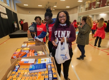 Student volunteers pack bags with canned goods during the second annual Radford Gives Back food drive.
