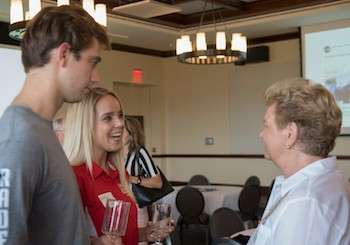 Brock Barnes, left, and Brittney Stowe, center, speak with BOV and Radford University Foundation member Georgia Ann Snyder-Falkinham.
