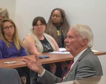 Judge James P. Jones talks with students during the Radford University Prelaw Society event in the courtroom inside the College of Humanities and Behavioral Sciences.