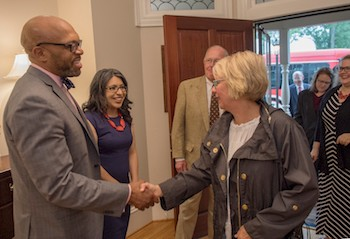 President Brian O. Hemphill (left) and First Lady Marisela Rosas Hemphill (second from left) greet new faculty members.