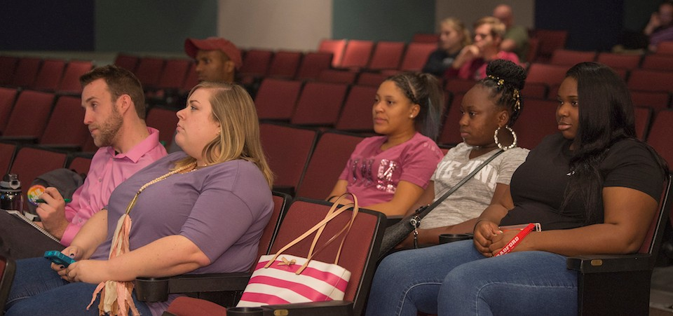 Students listen as Radford University President Brian O. Hemphill addresses students during the Presidential Open Forum.