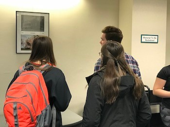 "Students wander the ""Then and Now"" gallery in McConnell Library."