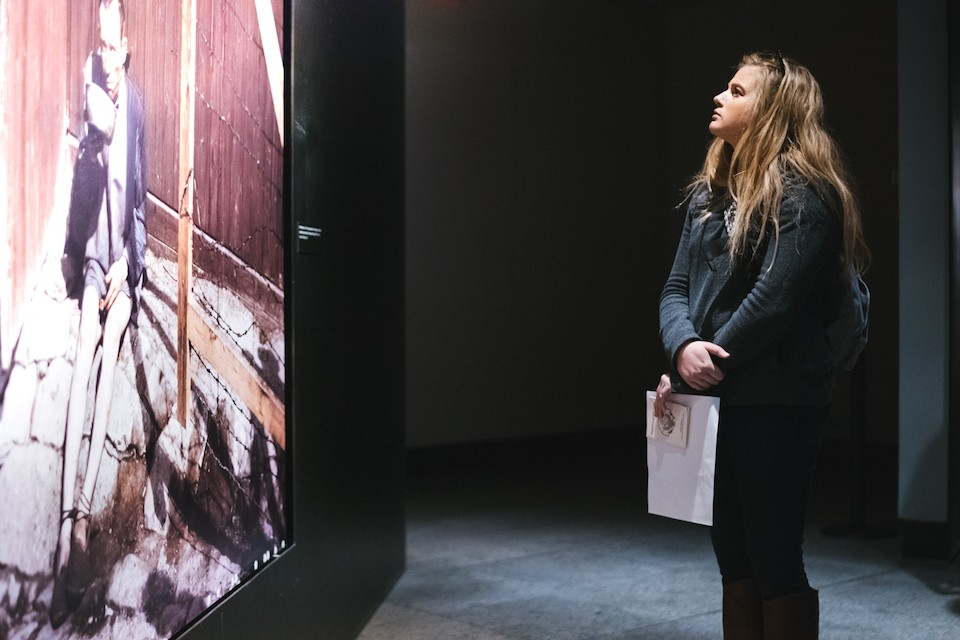 Sarah Derrick examines an exhibit at the United States Holocaust Memorial Museum.