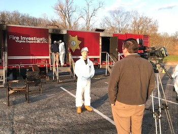 Nick Brown talks with the media during the arson investigation exercise.