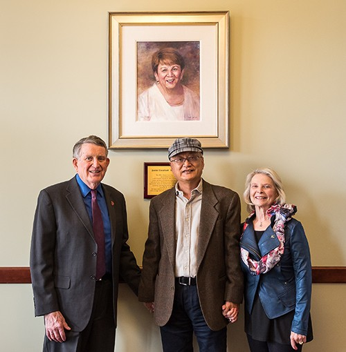Pat and Nancy Artis with Radford University art professor Z. L. Feng (center) at the unveiling of the portrait of Janice Eisenhart.