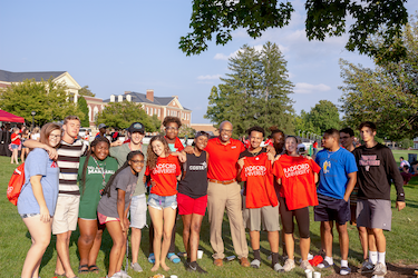 New members of the Radford Family have their photo taken with President Brian O. Hemphill at a picnic after New Student Convocation.