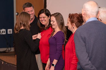 Smiles abounded on family and students as one the twenty-person MOT Class of 2018 were pinned and joined their profession on Dec. 14.