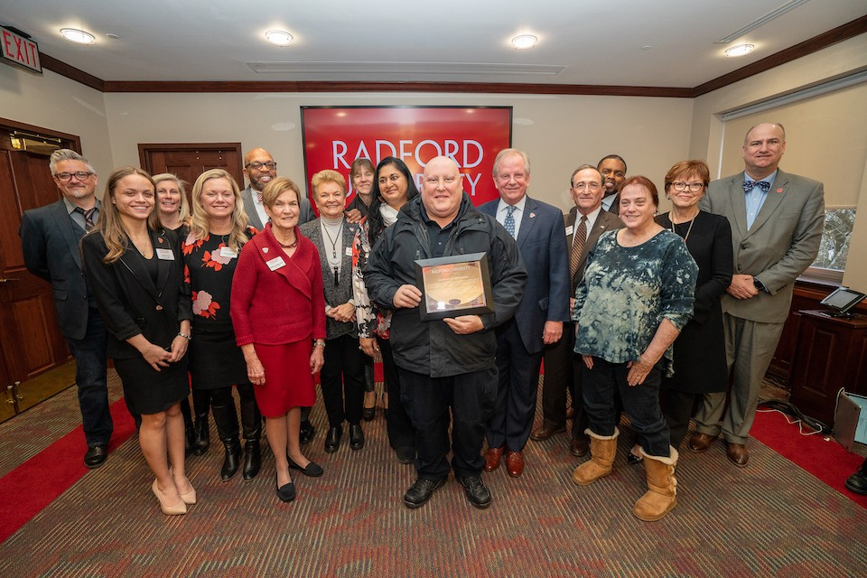 Bobby Hickman, center, was honored by the BOV for his outstanding service to Radford University.