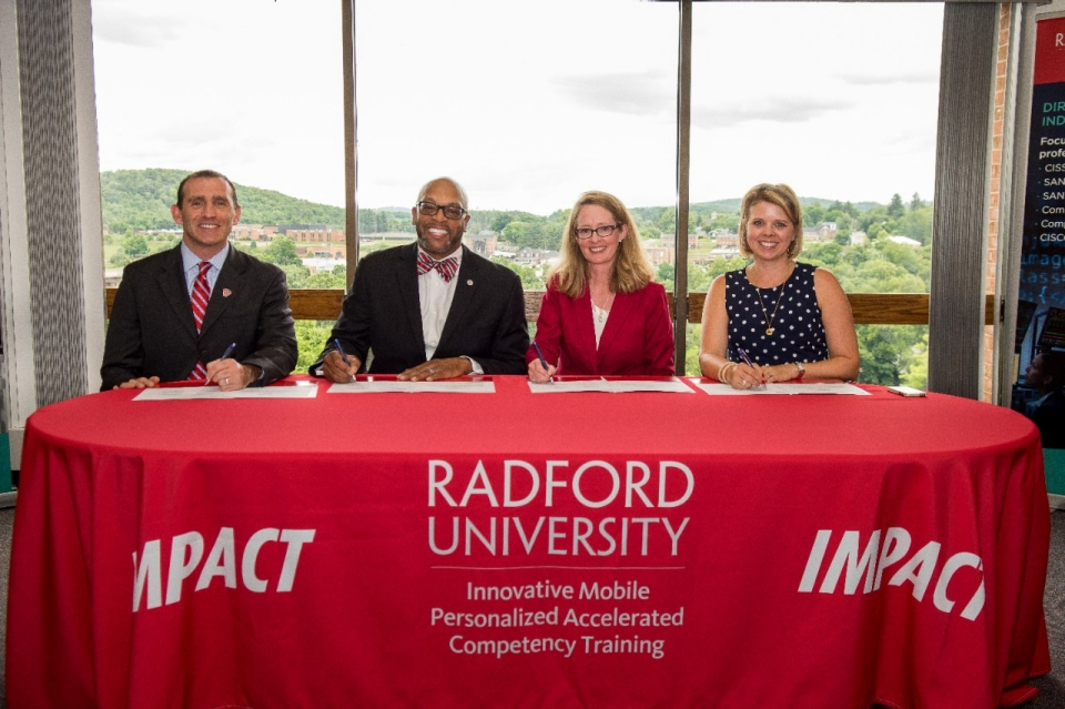 IMPACT Executive Director Matt Dunleavy, Ph.D. (from left), President Hemphill, New College Institute Executive Director Leanna Blevins and Assistant Director of Academics and Communications Melany Stowe