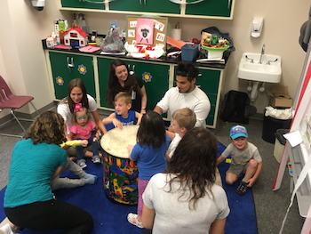 Music Therapy students work with children in the Preschool Language Lab