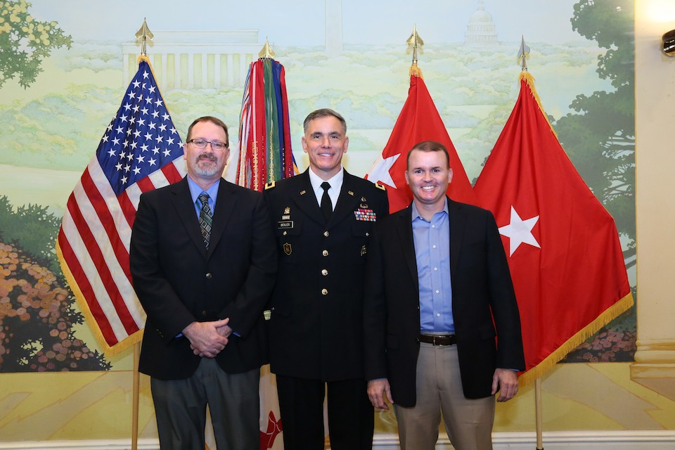 New US Army Brigadier General Jay Bienlien (Radford University '90) is flanked by Peter Rasmussen '90 (left) and Arin Durr '94 at his promotion ceremony March 23 at Patton Hall, Fort Meyer, VA. (Photo credit: Marla J. Hurtado)