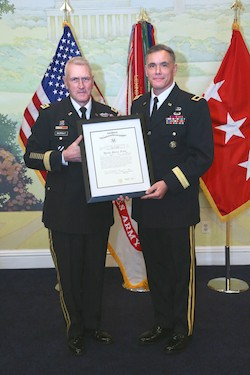 New US Army Brigadier General Jay Bienlien (Radford University '90) receives his promotion order from US Army Lieutenant General Mike Murray on March 23 at Patton Hall, Fort Meyer, VA. (Photo credit: Marla J. Hurtado)