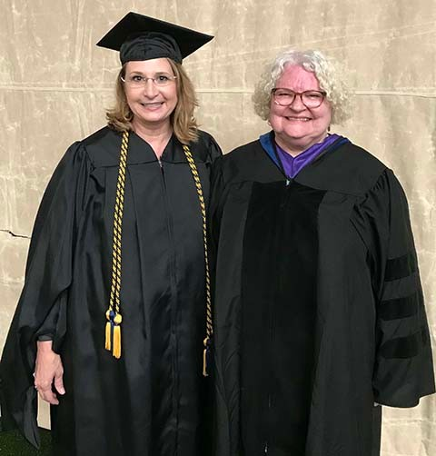 Kathy Douglas '93, MSW '08 (left) and Professor Emeritus of Social Work Alice King-Ingham (right)