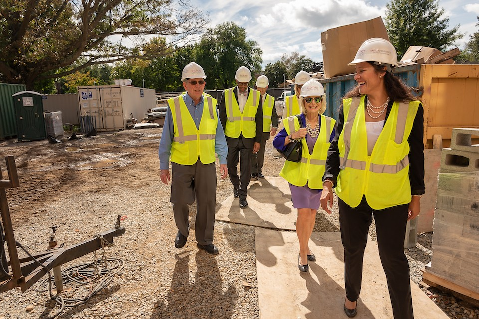 Vice President for University Advancement Wendy Lowery, right, leads Nancy Artis '73, second to right, Pat Artis, left, and President Brian O. Hemphill, center, through the renovations to the Artis College of Science and Technology.