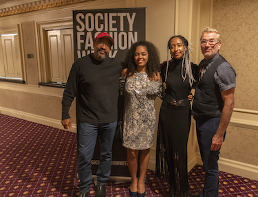 Farrel Doss, left, Destiny Howard, second to left, and John Jacob, right, after Howard's collection was displayed at Society Fashion Week.