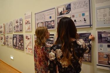 Two students discuss projects in the Interior Design and Fashion program.