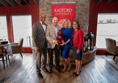 President Brian O. Hemphill, Ph.D. and First Lady Marisela Rosas Hemphill, Ph.D. honor the first recipient of The Spirit of the Tartan Award, Tom McGlothlin, joined by his wife Sandy McGlothlin.