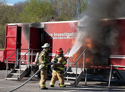 Firefighters put out the fire during the arson investigation exercise.