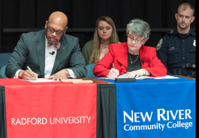 Radford University President Brian O. Hemphill, left, signs the pathway agreement with NRCC President Pat Huber, right.