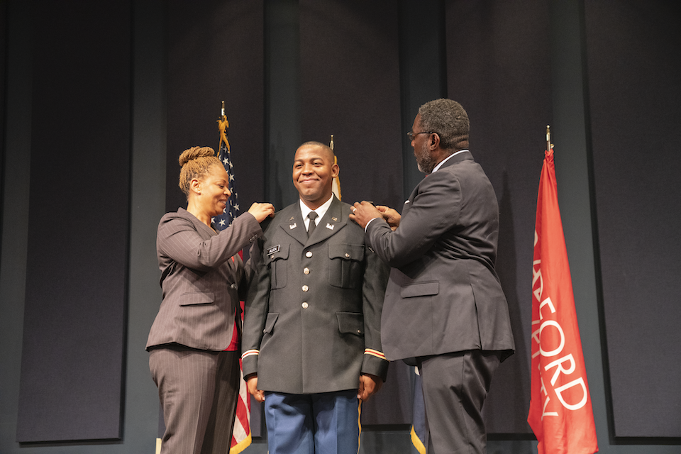 Sinclair's parents pinned him during the commissioning ceremony.