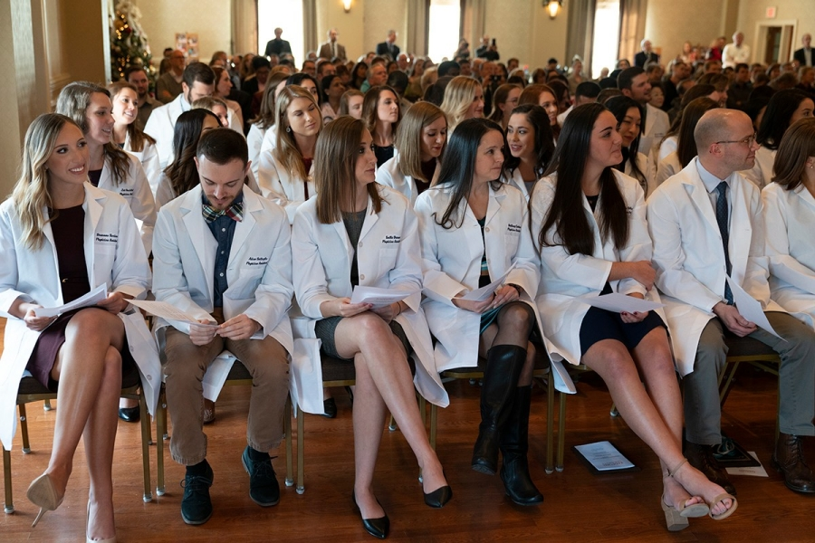 PA students prepare to read the Physician Assistant oath after receiving their white coats.