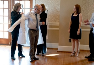 A PA student receives his white coat.