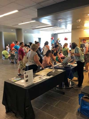 Visitors enjoy activities in the Center for the Sciences during the Apollo 11 celebration on July 20.