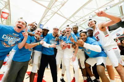 Caleb Tanner, center right, after winning the 2018 Big South Championship.
