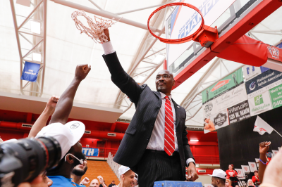 Coach Mike Jones cuts down the nets after Radford's thrilling victory over Liberty in the 2018 Big South Championship.
