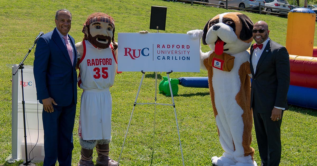 JCHS President Nathaniel L. Bishop, D. Min, left, and Radford University President Brian O. Hemphill, Ph.D., right, unveil the Radford University Carilion name and logo.