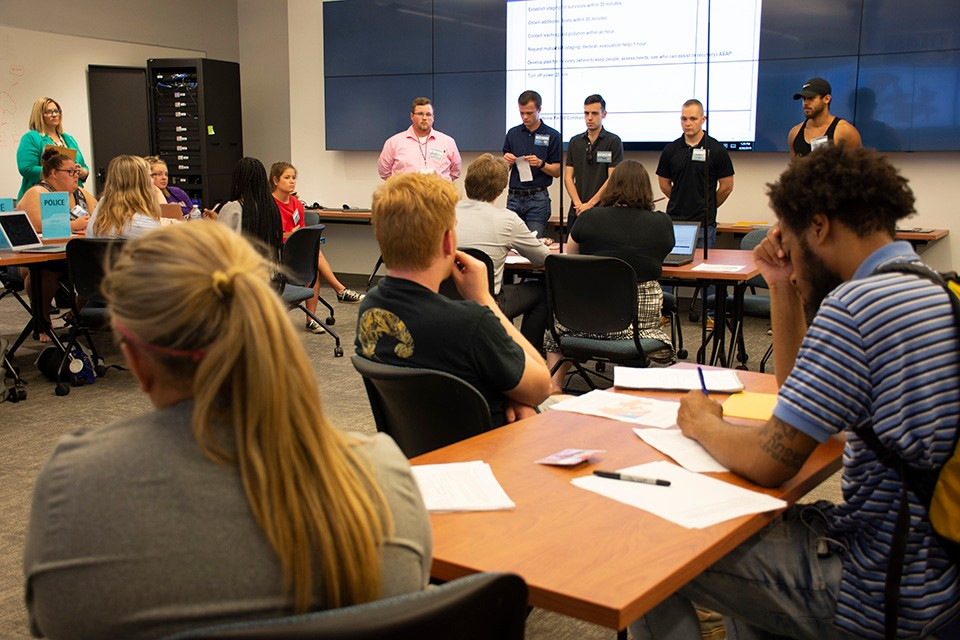Students participate in the mock press conference at the end of the first day of the simulation.