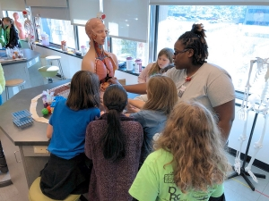 "STEAM Day participants learn anatomy and physiology in the ""The Lab Experience."""