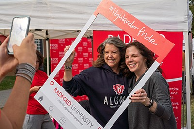 Two alumni pose for a picture during the 2019 Alumni Village.