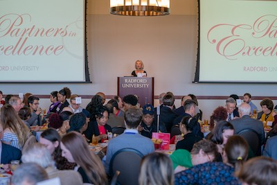 Nancy Artis '73 speaks during the Partners in Excellence luncheon.