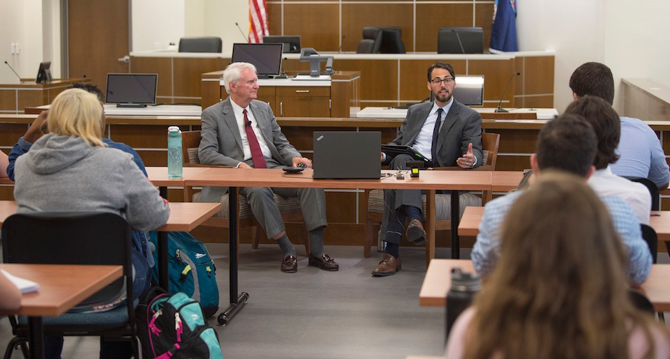 Radford University Assistant Professor of Criminal Justice, Luke Hunt, right, speaks with Federal Judge James P. Jones, left, during the Radford University Prelaw Society event in the courtroom inside the College of Humanities and Behavioral Sciences.