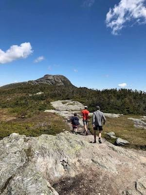 Hunt, center, trail running with his son, Henry, left, and his father, right, at Vermont's Mt. Mansfield.