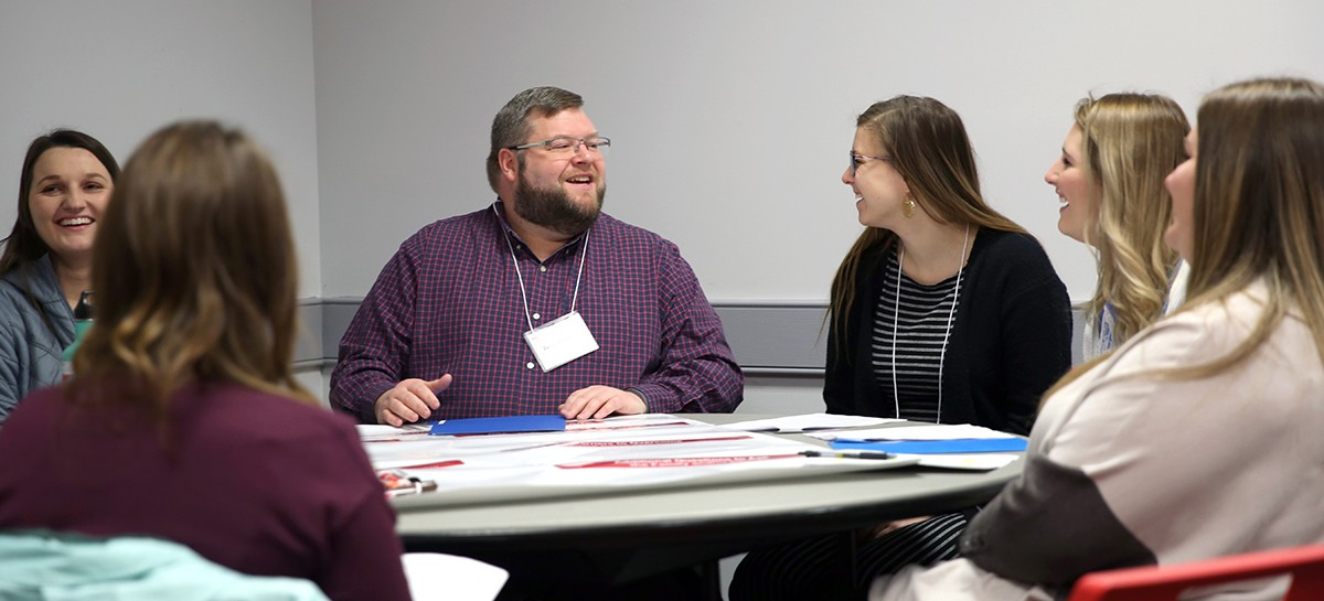 Jason Browning, M.S., assistant professor in the department of Occupational Therapy, moderates a group of students during the IPE activity.