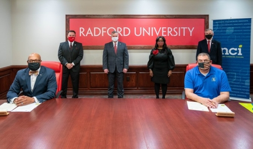 Radford University President Brian O. Hemphill, Ph.D., and NCI executive vice president, chief operating officer and chief financial officer Chuck Hicks signed a memorandum of understanding (MOU) on January 5, 2021.