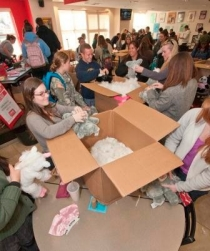 Students participate in a program putting together stuffed animals.